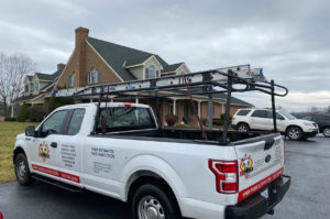 Fab Build Pro Truck parks at house with asphalt shingles roof